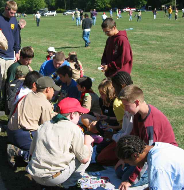 Scouts trading badges near the main field